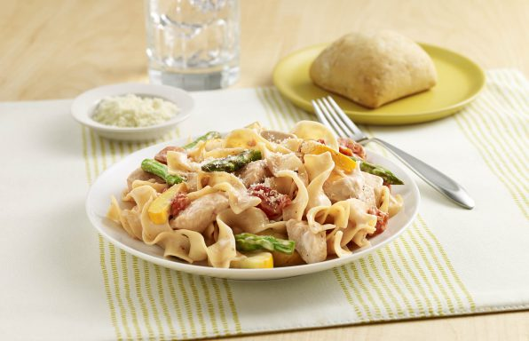 Chicken Noodle Primavera An egg noodle recipe with chicken, fresh vegetables, seasoned tomatoes and Alfredo sauce.