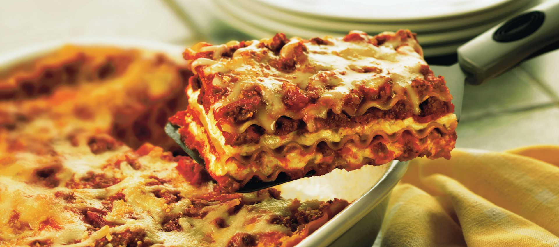 Classic sausage lasagna with layers of noodles, tomato sauce, Italian sausage, and cheese