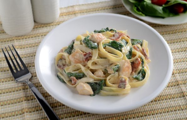 Linguine with bacon, Alfredo sauce, diced chicken, fresh spinach, and Parmesan cheese