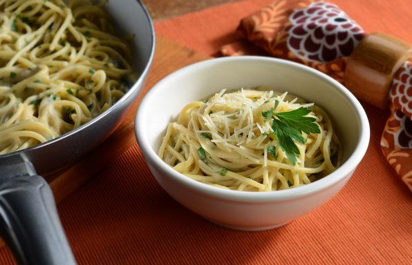 Herb linguine with Alfredo sauce, basil, and fresh parsley, topped with Parmesan