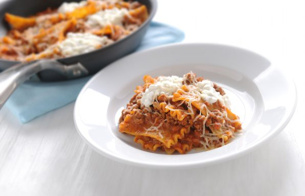 Italian skillet lasagna with ground beef, pasta sauce, ricotta, and Italian shredded cheese