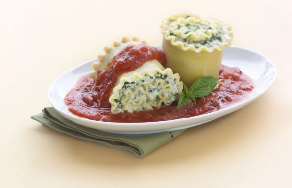 Spinach lasagna rolls stuffed with ricotta and spinach, topped with tomato sauce