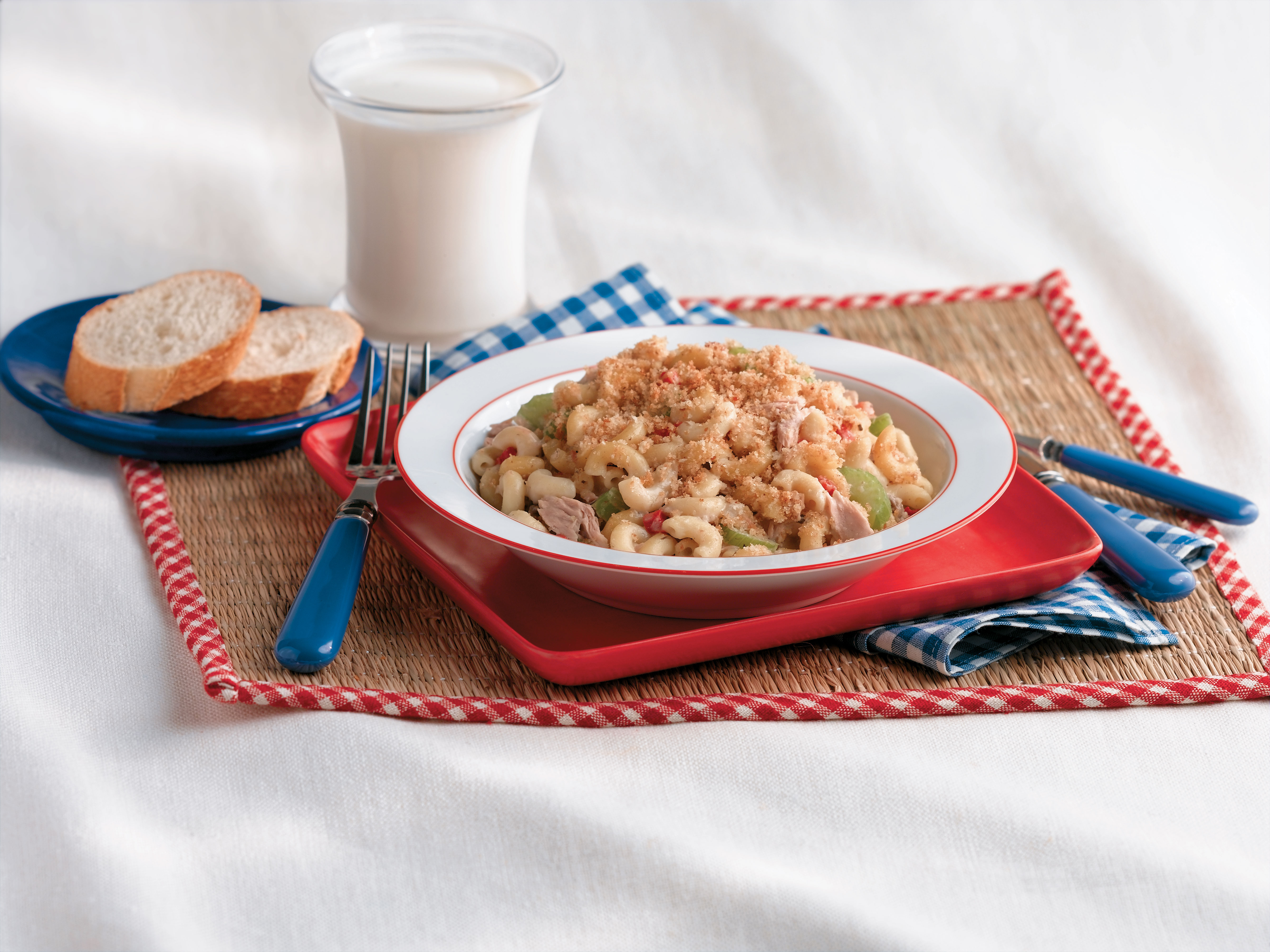 Picnic macaroni salad with elbows, celery, and green peppers, topped with bread crumbs